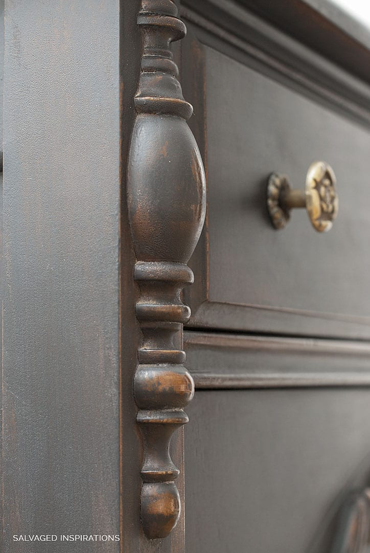 Close Up of Distressed Caviar Black Paint on Vintage Dresser