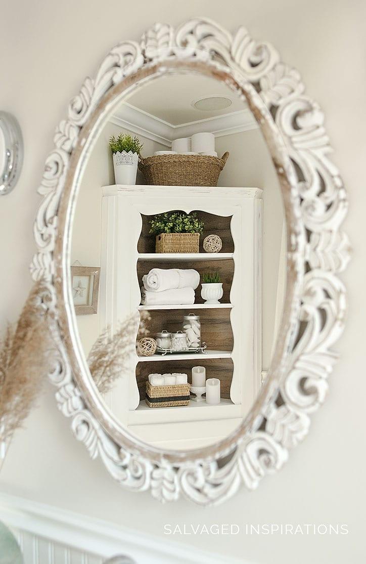 Reflection of Corner Cabinet with Barnwood Backing