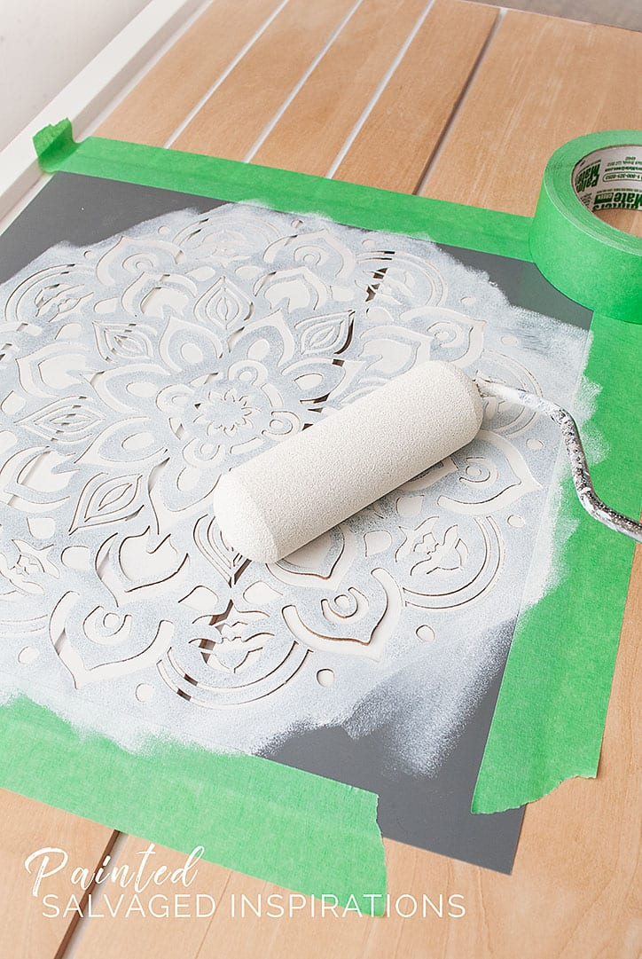 Rolling Paint onto Mandala Stencil For Dresser Makeover