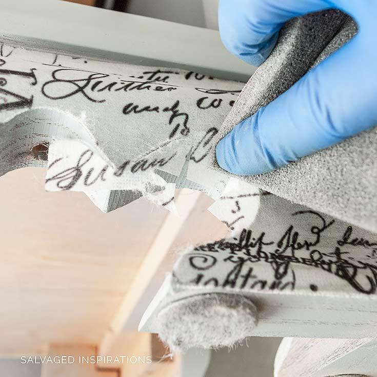 Trimming off Decoupage Paper w Sandpaper