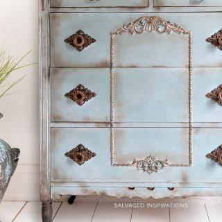 Close Up of Copper Gilded Trim Design on Dresser