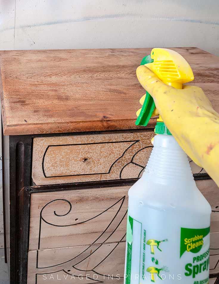 Spraying Bleach On Wood