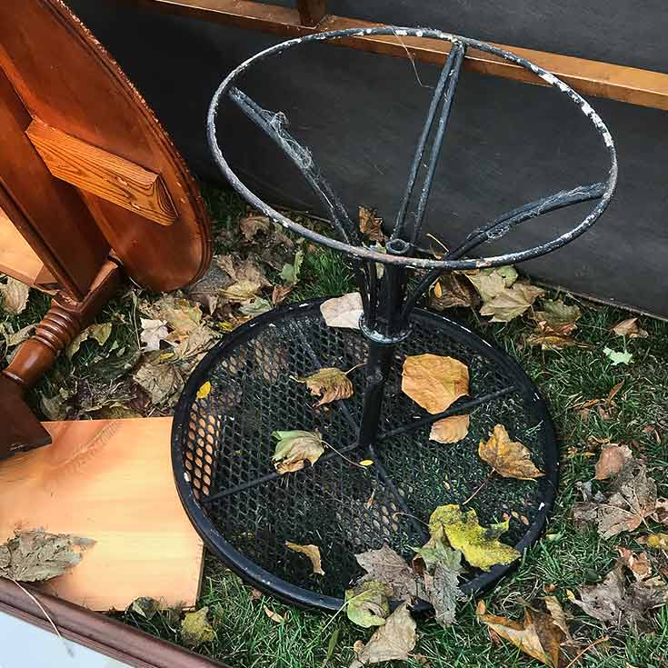Rusted Metal Table in Trash